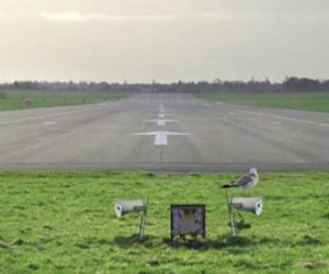 Loud speakers installed at the end of an airport runway.
